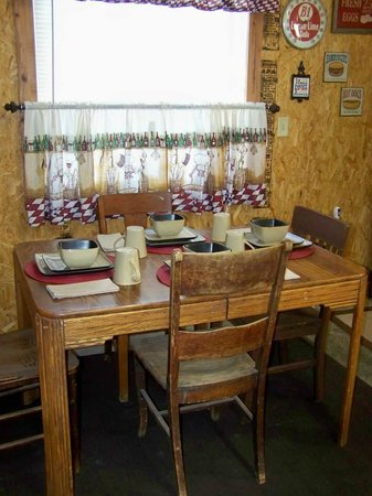 The Gathering Place Retreat Center: The Cabin has an oak table set for guests