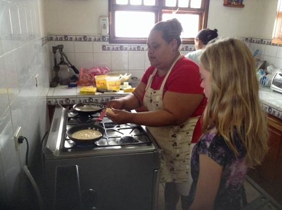 Rosanna and Evalina making pancakes at Hotel Villa Isabella