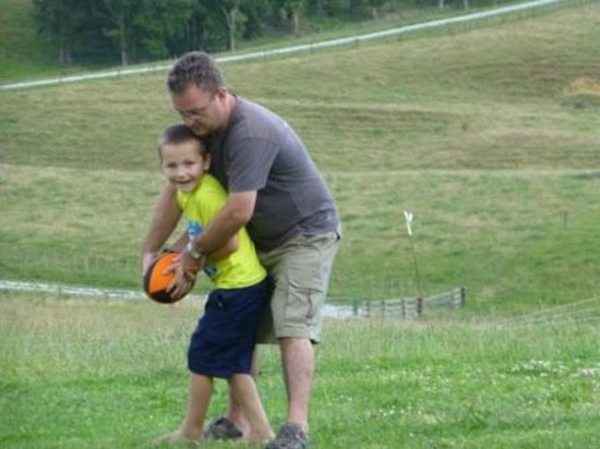 A Kiwi Farmstay: Lukah and Simon playing rugby