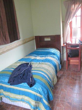 Terrace Lodge & Tours: Удобная кровать в теплом номере