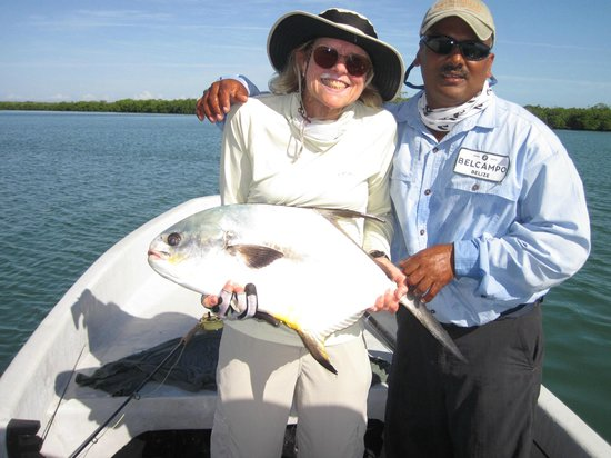Belcampo Lodge: Alex, our guide, & Patti, a happy fishing lady!