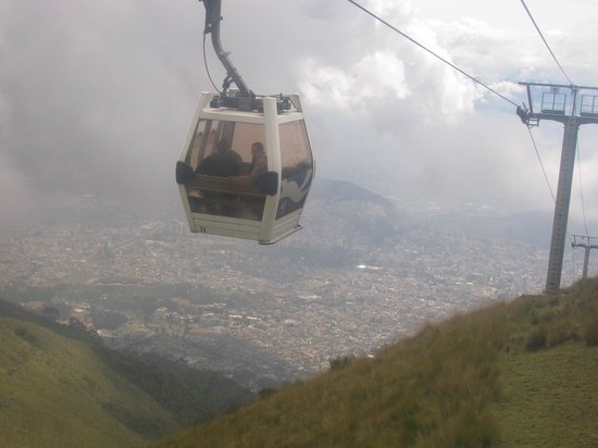 Teleferico Quito: A cable car going up.