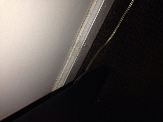 The Court – A St Giles Hotel : Dust on floor molding in room 702.