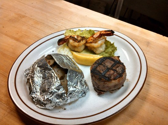 Mad Mary's Steakhouse & Saloon: 5 oz filet with 2 Cajun prawns and tin taters on the side a special they run