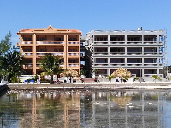 Hol Chan Reef Villas: The resort from the dock.  The new addition is nearly done