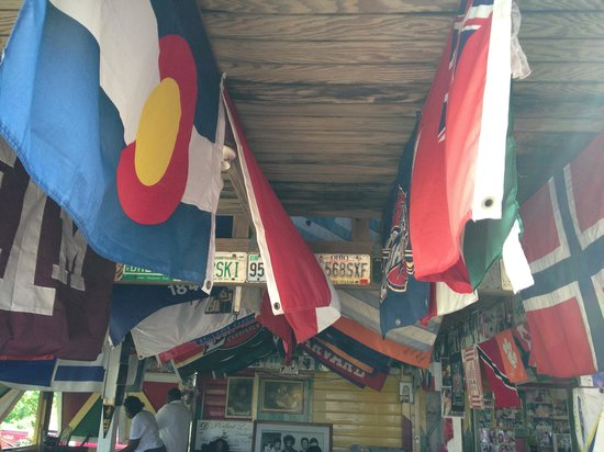 Sunshine's Beach Lounge : Pull up a cushion , Sit under the flags !