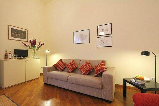 Zona soggiorno con divano letto foto di relais martinez - Divano letto firenze ...
