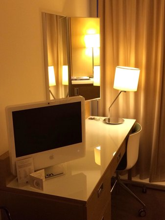 DoubleTree by Hilton Manchester Piccadilly: Apple MAC computer and TV with build in DVD player (key board and mouse in the drawer)