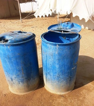 Camp Oasis India : Raw water in plastic tanks used for cooking
