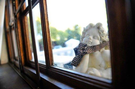 5th Avenue Gooseberry: Angel peeping through diningroom window