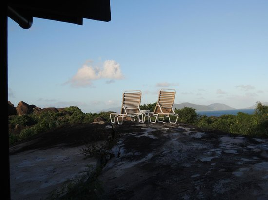 Guavaberry Spring Bay Vacation Homes: View off deck of boulder and beyond