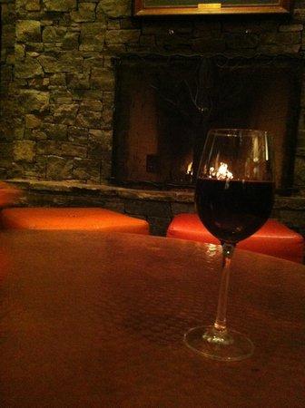 Stowe Mountain Lodge : Wine at lobby fireplace.