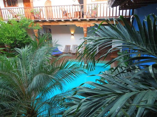 Miss Margrit's Guest House: Every room's balcony overlooks the gardens and pool area