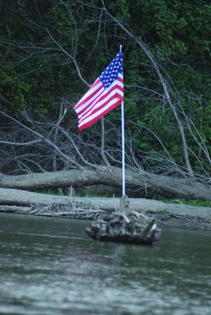 Shoals, IN: Flag Flying in the Middle of White River