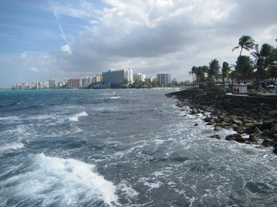 Caribe Hilton San Juan: View from the Hilton's mini-pier. Rocks on this side. Their private beach on the other