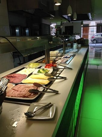 Rocca Nettuno suites: Breakfast line Rocca Netuno/ Aquis Rocca Suites December 2013