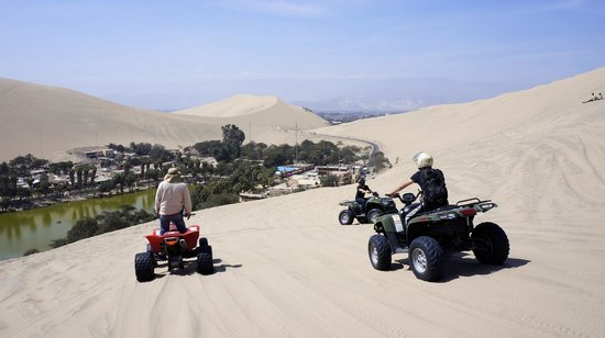 Dune buggying near the oasis (in Huacachina, Ica, Peru)