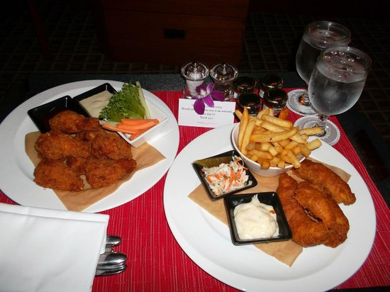 Swissotel The Stamford: room service food, beer battered fish and chips and chicken drumlets with blue cheese and bbq di