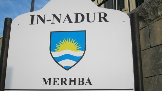 Narcisa: The rising sun emblem for Nadur village