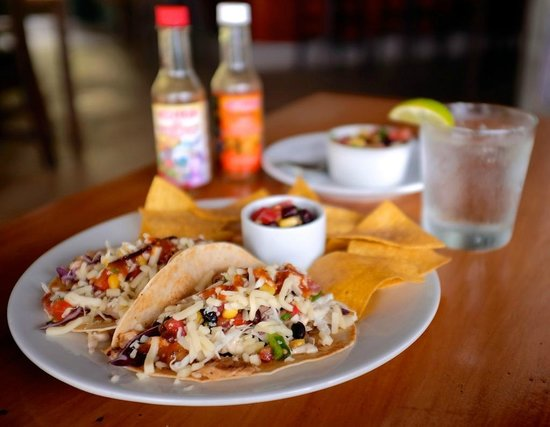 Pagua Bay Bar and Grill: Our famous Taco's; choose fresh fish, chicken, goat or veggie...BTW, eat these with your hands:)