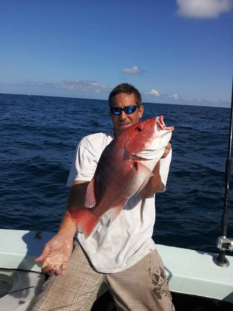 Reel Trick Charters: First Mate Jason.  Nice catch!