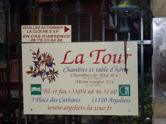 Notice on the gate to La Tour