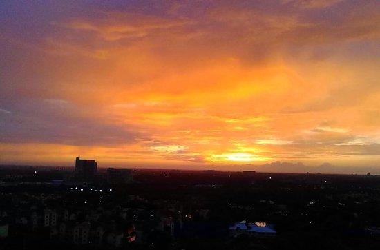 Blue Heron Beach Resort : Sunset over Downtown Disney from balcony
