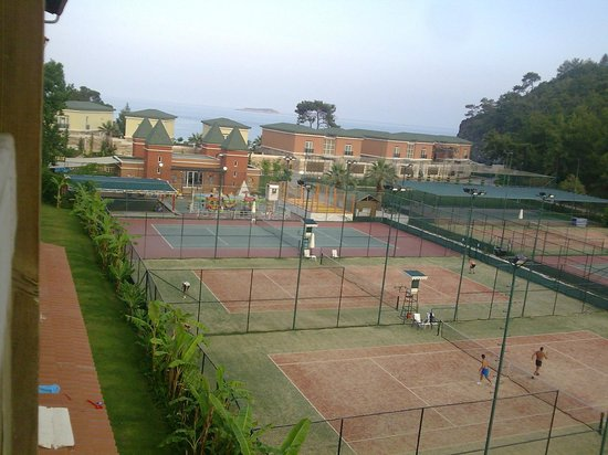 Amara Dolce Vita Luxury: Tennis courts -view from room on Roma St.