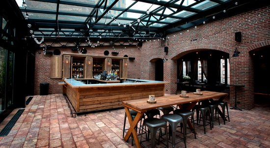 Year Round Patio with Retractable Glass Roof at Refinery Rooftop
