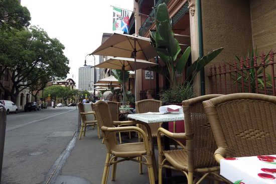 The Tea Cosy: Street view. The tables and chairs are set in to a normal front yard type space, and the footpat