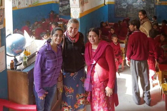 Saini Guest House: Two of the 8 classrooms with Rajan, her daughter and me