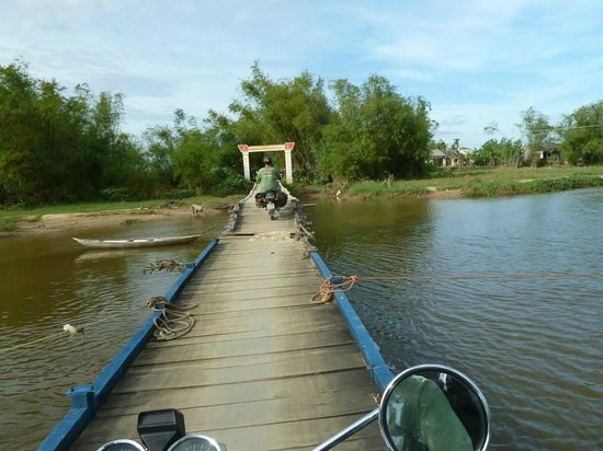 Hoi An Motorbike Adventures: One of the last remaining wooden bridges! Real fun passing it!
