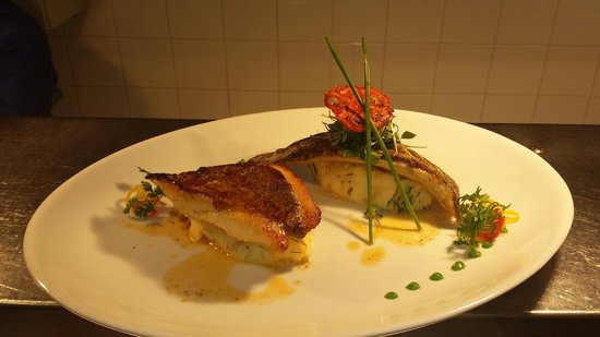 Gallagher's: Pan -seared seabass and john dory, on red onion and dill mash with languistine butter.