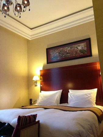 Kempinski Hotel Cathedral Square: A pic of our room. Much bigger in real life, the bed is larger than it seems.