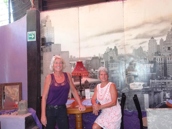 Uncommon Grounds Chill Out Lounge: Anne and Lydia with a picture of NY in the back ground, where they moved from