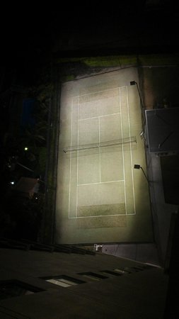 Mantra Wings: Tennis court from above at night