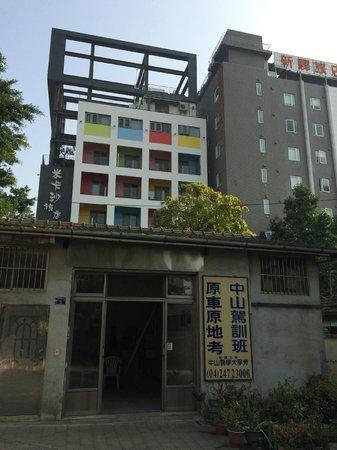 CityInn Hotel Plus - Taichung Station Branch: CityInn hotel can be seen from Taichung Rear Station (the gray building)