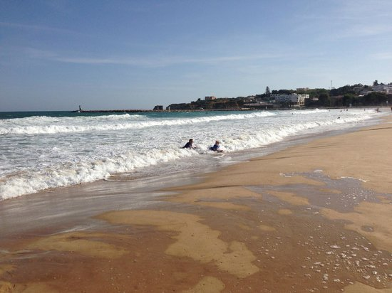 Meia Praia catching waves