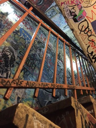 Alternative Berlin Tours: Graffiti filled stairwell near cafe Cinema