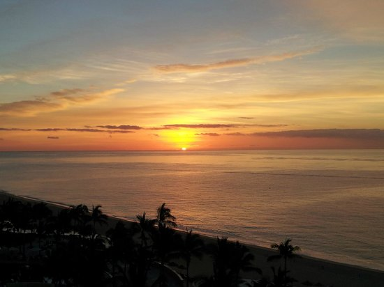 Marquis Los Cabos All-Inclusive Resort & Spa: 7 am sunrise from balcony with coffee from in-room maker.