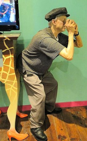Ripley's Believe It or Not!: life-like wax figure taking YOUR picture