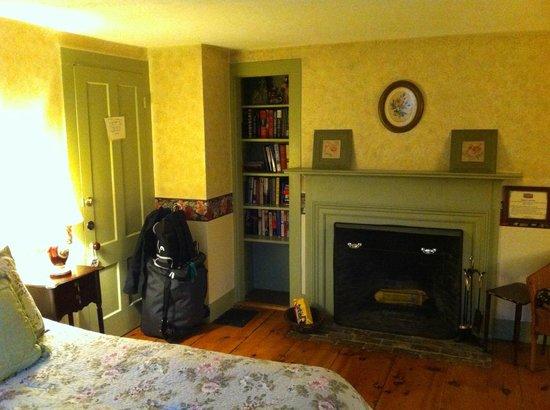 Nutmeg Inn: The (unlit) wood burning fireplace in the Clove room.