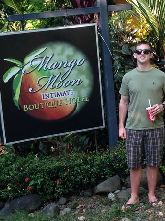 Mango Moon Villa: Happy customer infront of the sign
