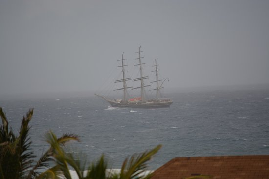 Le Pavillon by the Sea: Ship passing le Pavillion during surprise downpour