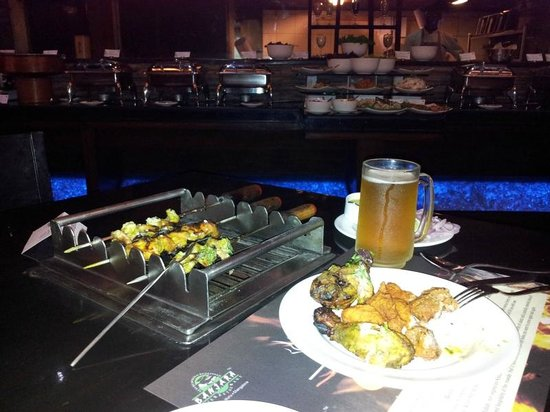Goldfinch Hotel Bangalore: Barbecue table with buffet dinner on roof top