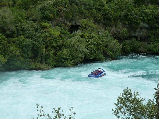 Huka Falls tracks: A jet boat zooms up to the base of the falls