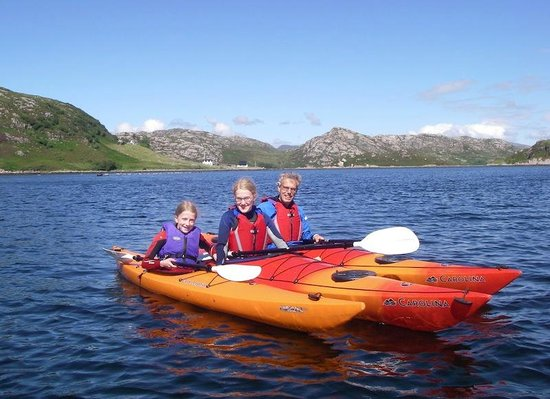 Ridgway Adventure - One Day Activities: Father and daughters with the crofts at Ardmore behind