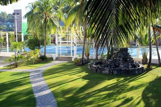 Garden and tennis court - Picture of Java Hotel, Laoag - TripAdvisor
