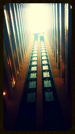 Stamford Plaza Melbourne : The view looking up from the atrium.  You can see one of the lifts at the top.
