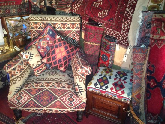 The Antiques Warehouse: Traditionally reupholstered chair covered in kilim